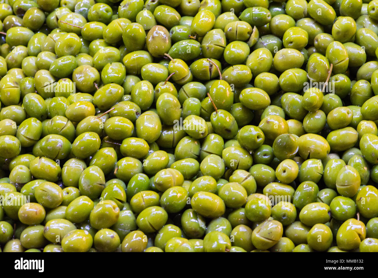 Pile of olives soaked in the water to keep them fresh for latre use - Stock Image