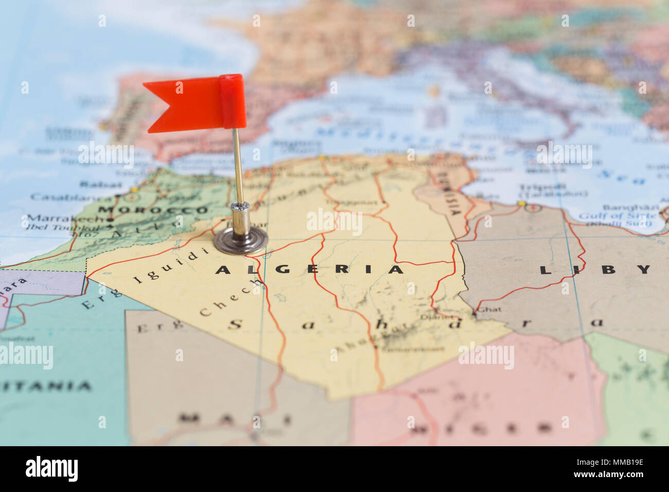 Small red flag marking the African country of Algeria on a ...
