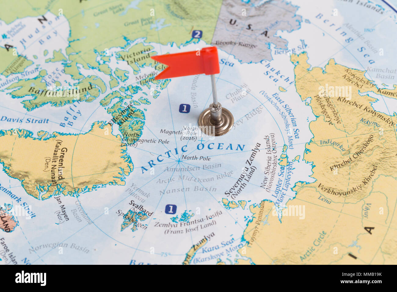 Flag Marking The North Pole And Actic Ocean On A World Map Stock