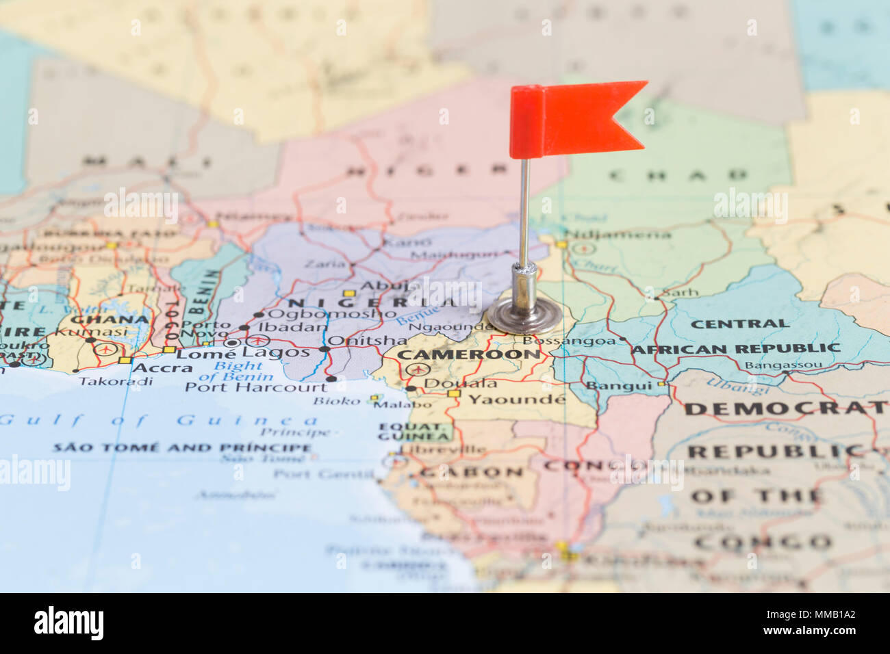 Small red flag marking the African country of Cameroon on a ...