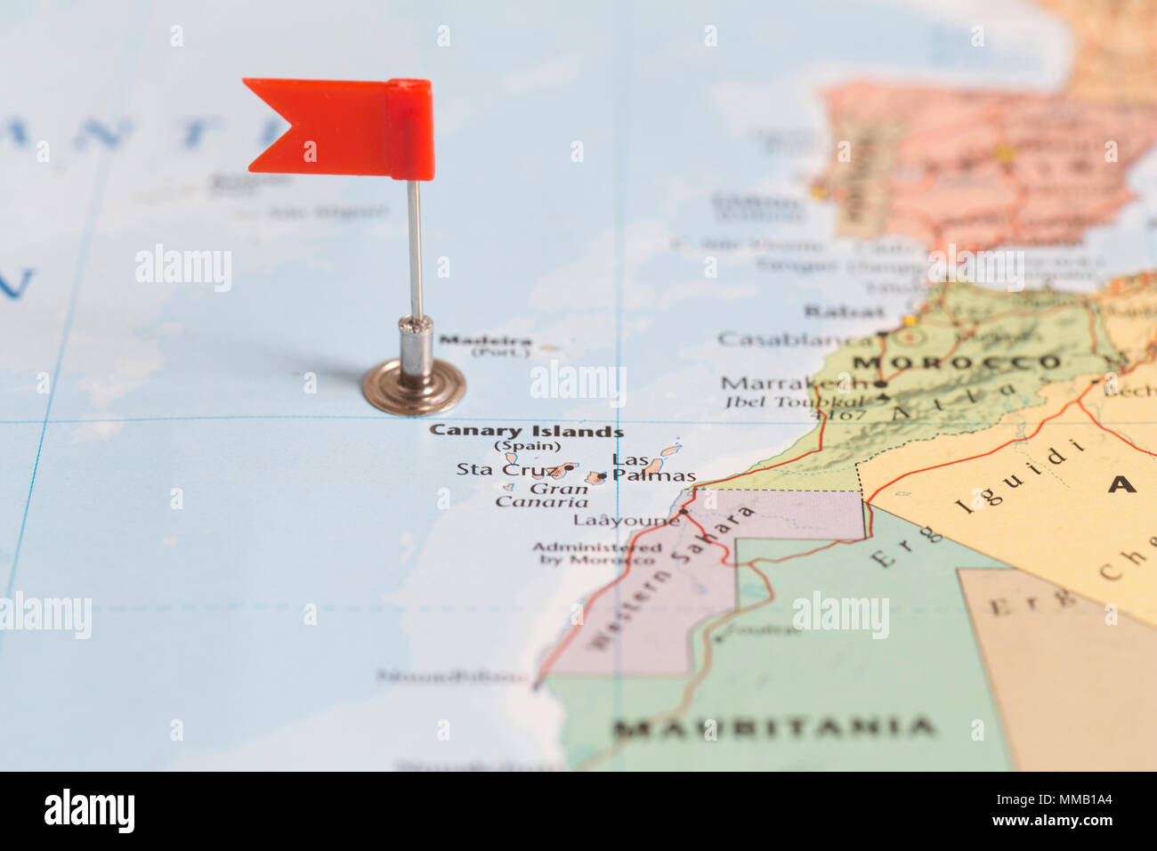 small red flag marking the canary islands on a world map stock image