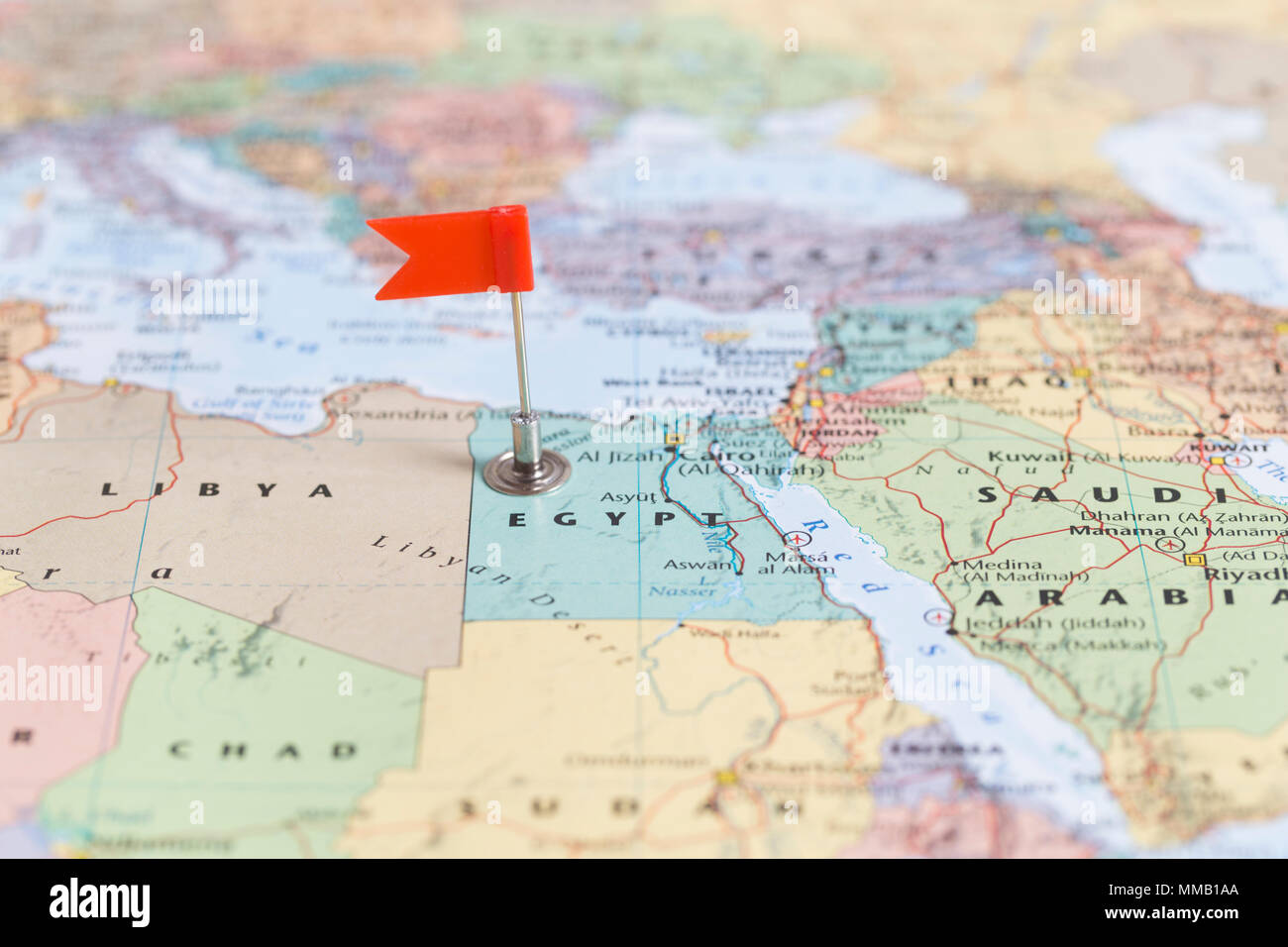 Small red flag marking the African country of Egypt on a world map on ancient egypt, geography egypt, the band egypt, kush egypt, camels in egypt, library of egypt, world atlas, arab six egypt, cairo egypt, africa egypt, physical features of egypt, jordan egypt, pyramids of egypt, pharaohs of egypt, neighbors of egypt, goshen egypt, land marks of egypt, animals egypt, winter in egypt,