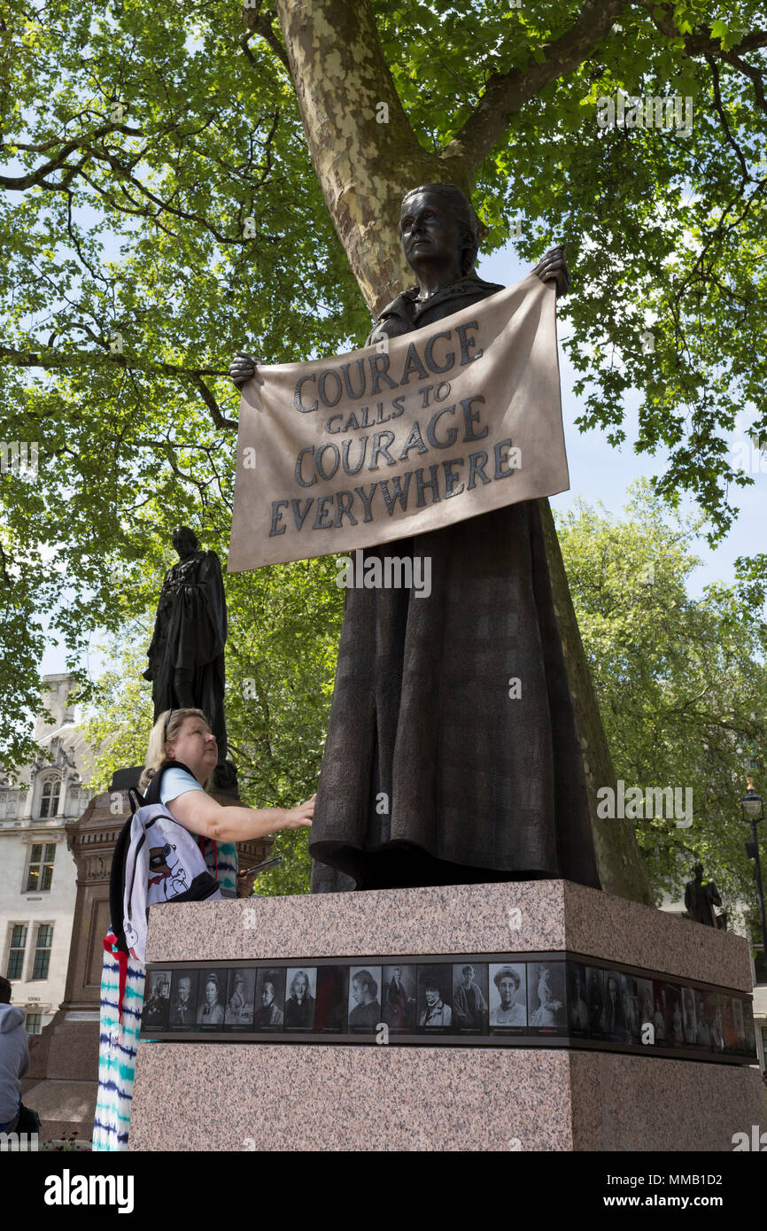 Admirers of suffragist Millicent Garrett Fawcett's statue, the first woman to appear among an all-male Parliament Square, on 9th May 2018, in London, England. Dame Millicent Garrett Fawcett GBE was a British feminist, intellectual, political leader, activist and writer. She is primarily known for her work as a campaigner for women's suffrage Stock Photo