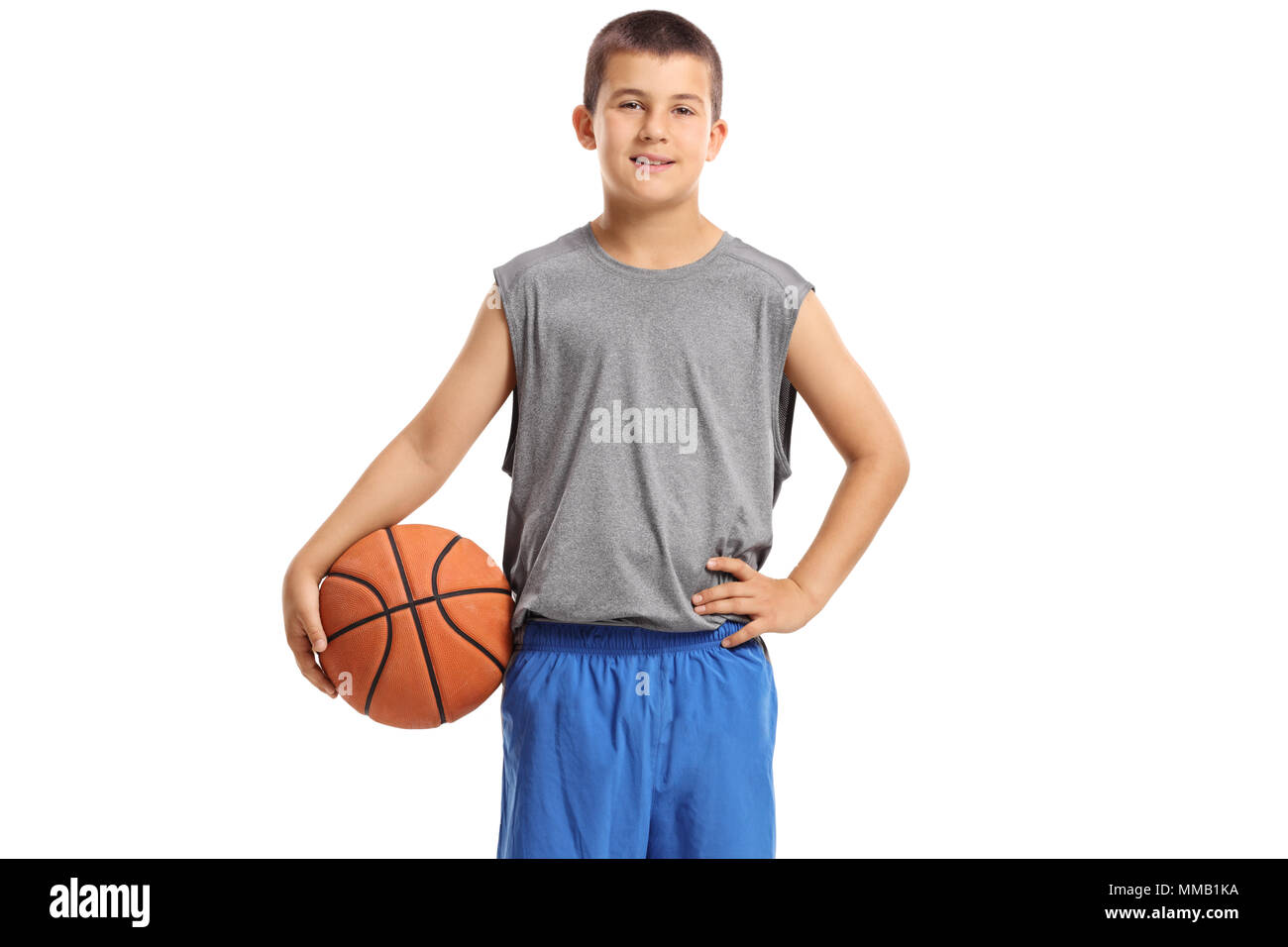 Boy with a basketball isolated on white background - Stock Image