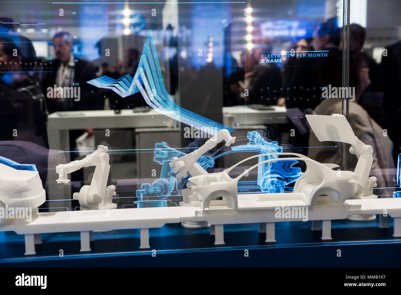 Hannover, Germany - April, 2018: Simulating of car manufacturing by robots, digital twin of the production on Siemens stand on Messe fair in Hannover, - Stock Image