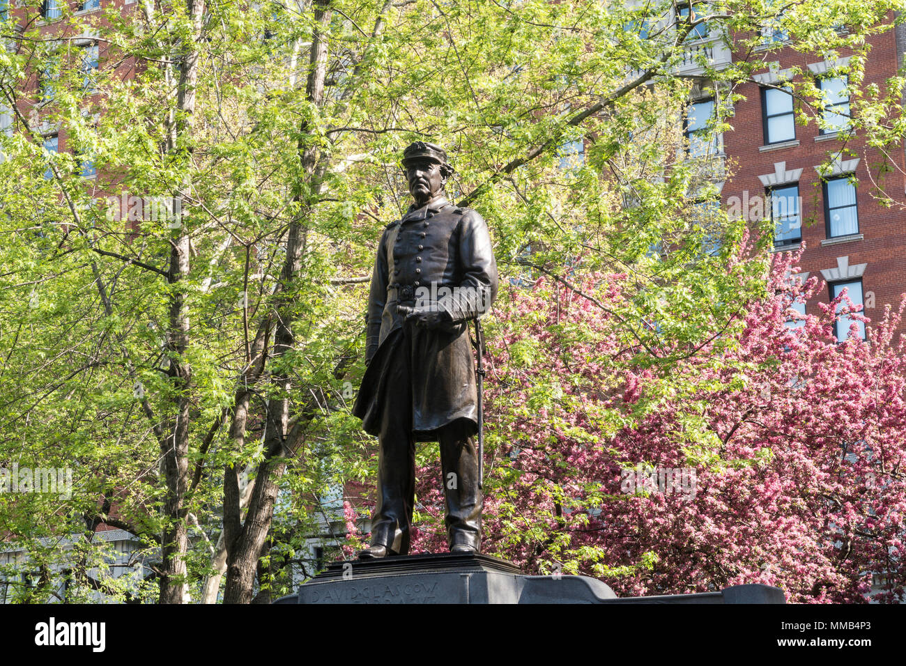 Farragut Monument is surrounded by beautiful spring trees in Madison Square Park, NYC, USA Stock Photo
