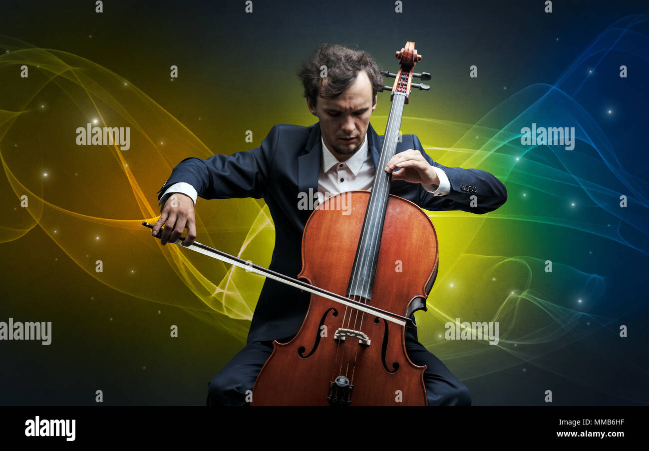 Serious classical cellist with fabled sparkling wallpaper - Stock Image