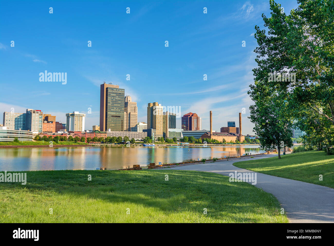 A panoramic view of downtown Toledo Ohio's skyline from across the Maumee river at a popular public park. Stock Photo