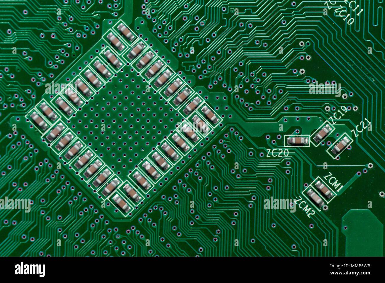 Ceramic Capacitors on Green Digital electronic circuit board texture ...
