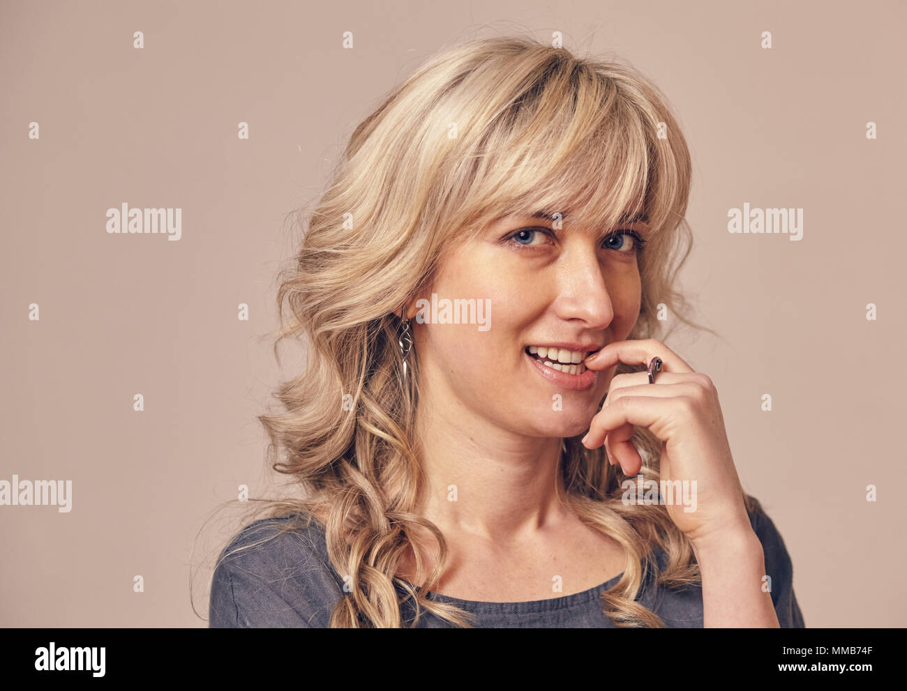 woman has some kind of cunning intention - Stock Image