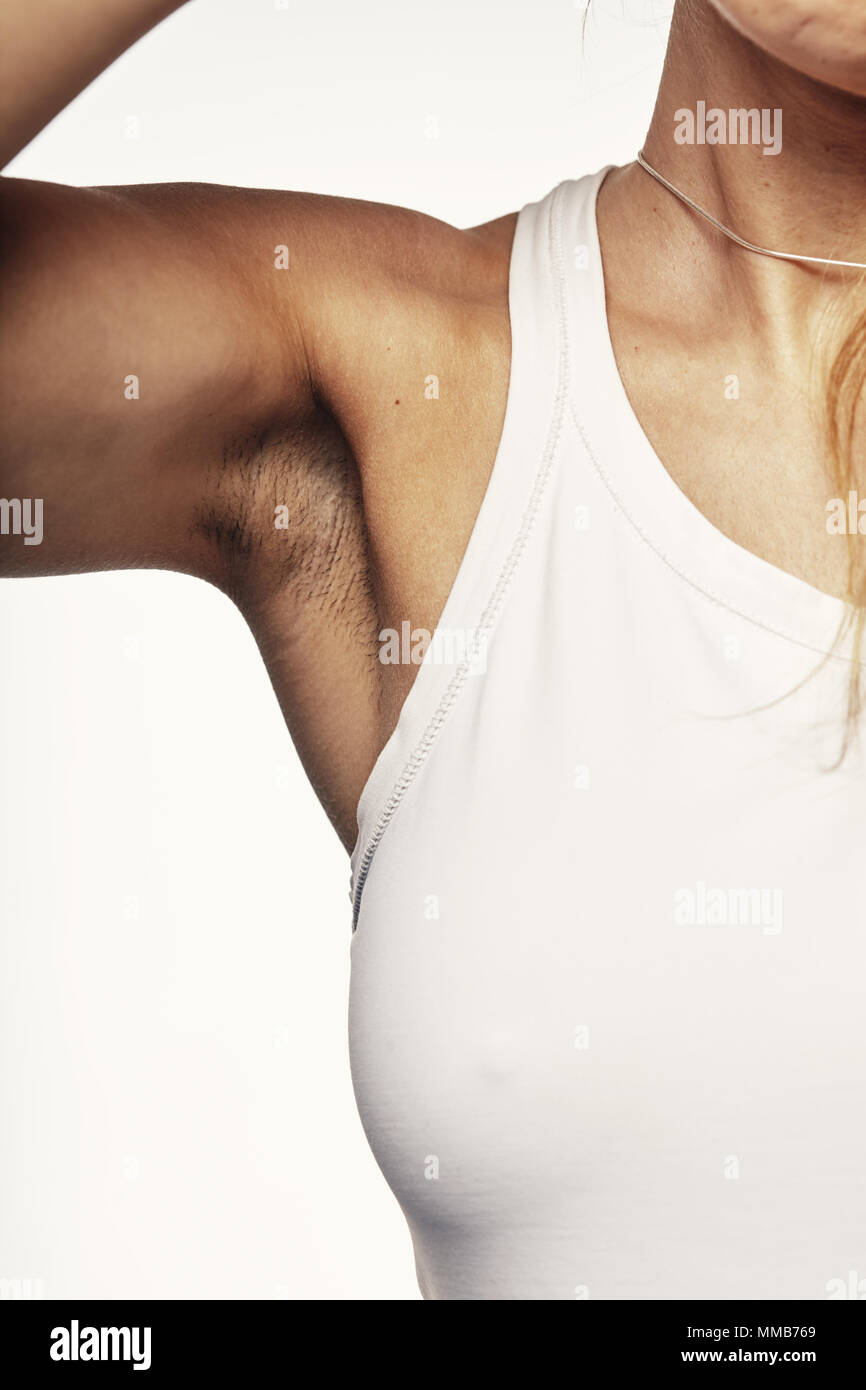 young woman demonstrates under the armpit - Stock Image