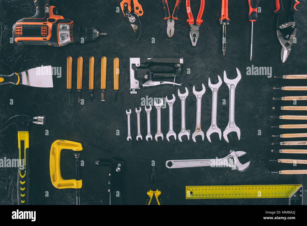 top view of set of mechanical equipment on dark tabletop Stock Photo