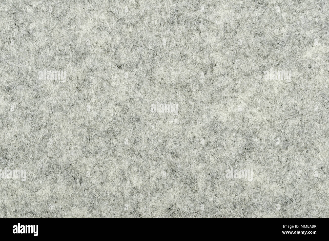 Gray felt surface. Textile material, made of matted synthetic fibers. White, gray and black acrylic pressed together. Fabric pattern. Background. - Stock Image