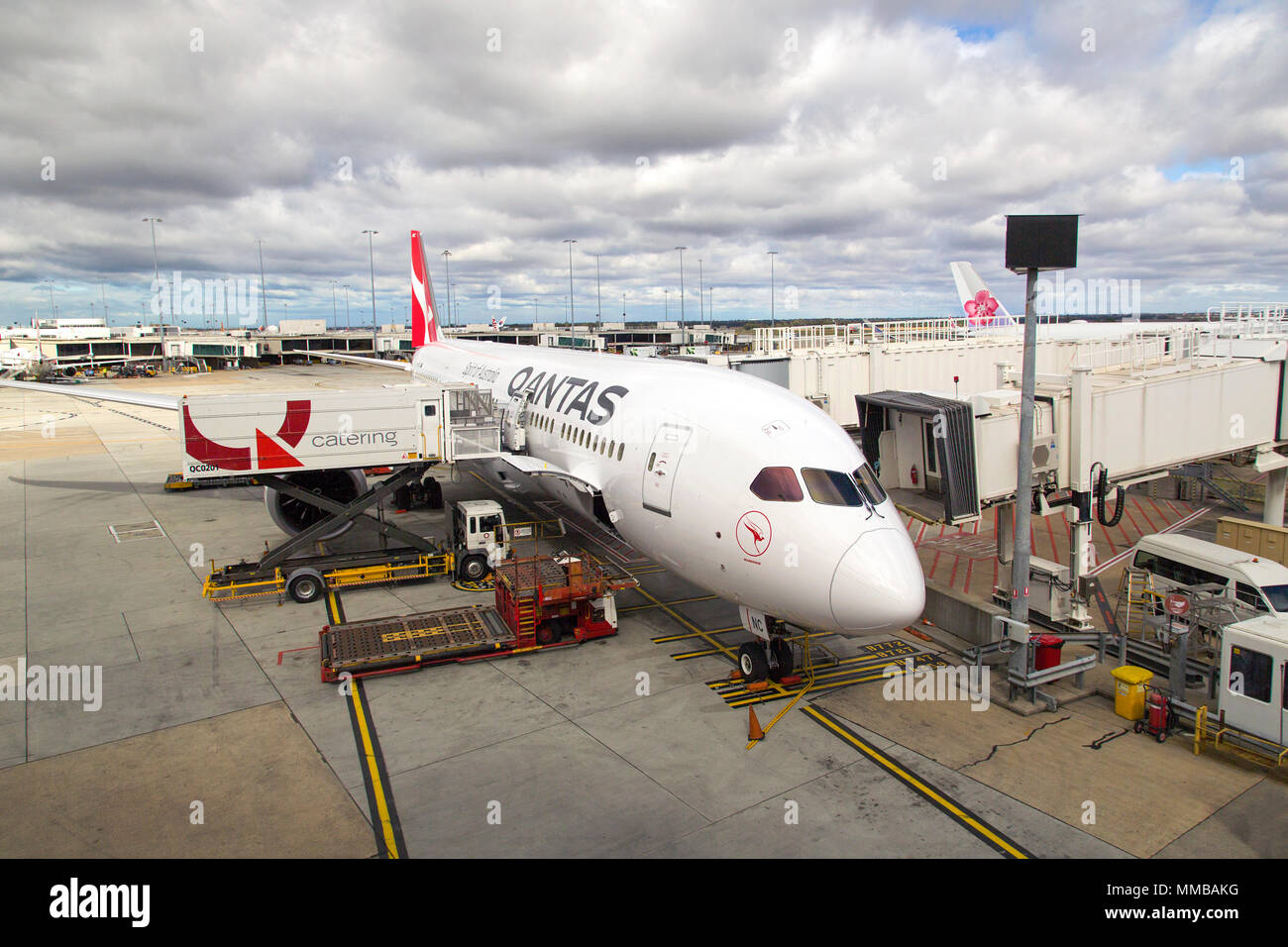 Melbourne, Australia: April 16, 2018: Qantas airplane at Tullamarine Airport being refuelled and restocked for the next flight. Qantas Airways is the - Stock Image