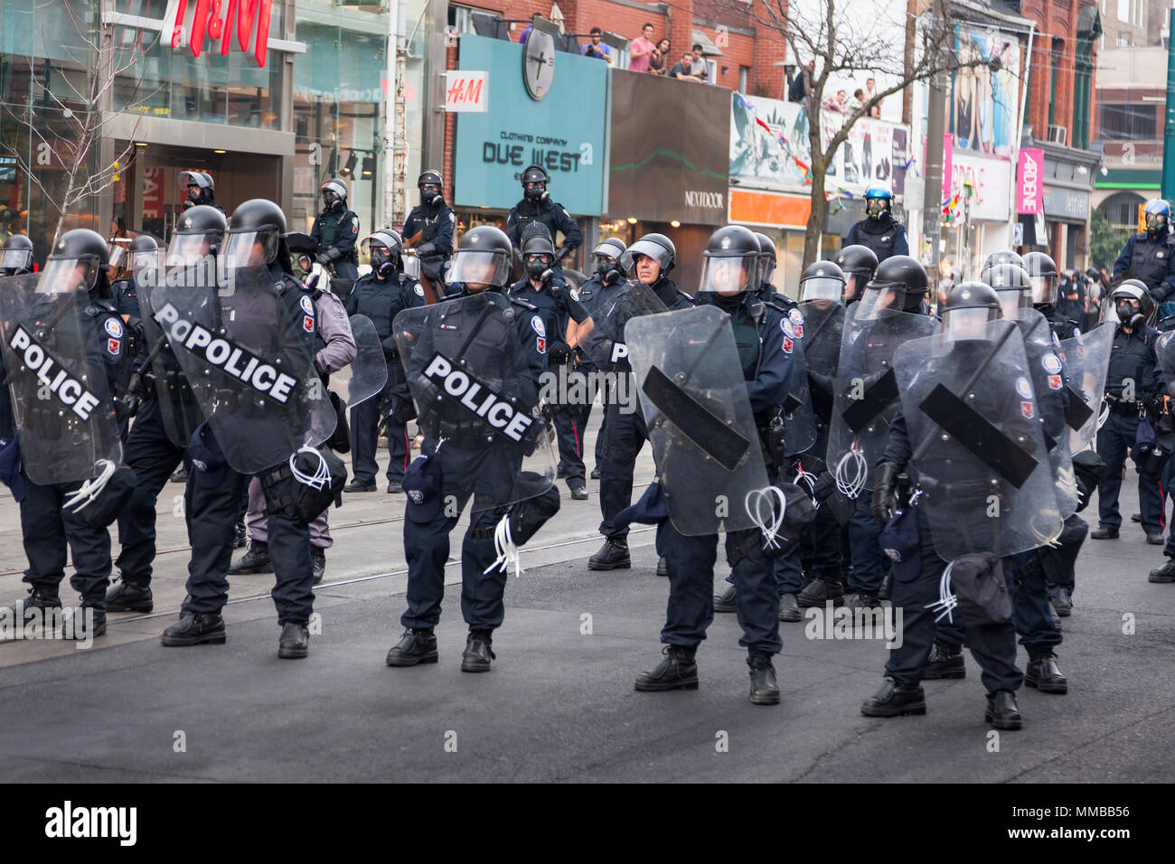 Riot police create a barricade along Queen Street West during the G20 summit in Downtown Toronto, Ontario, Canada. - Stock Image