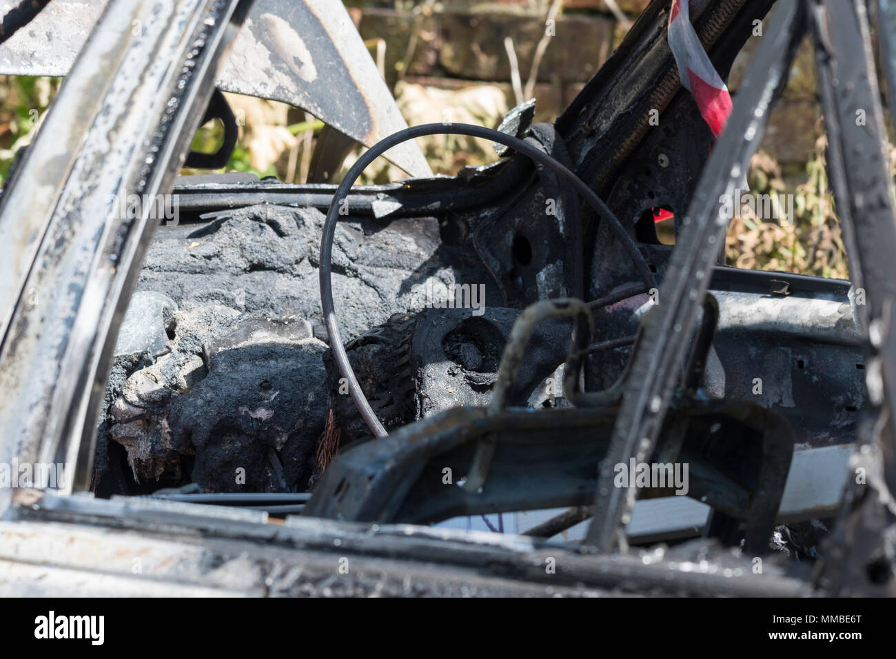 Burned out abandoned car after a fire, in the UK. Burnt out car. Auto fire. - Stock Image