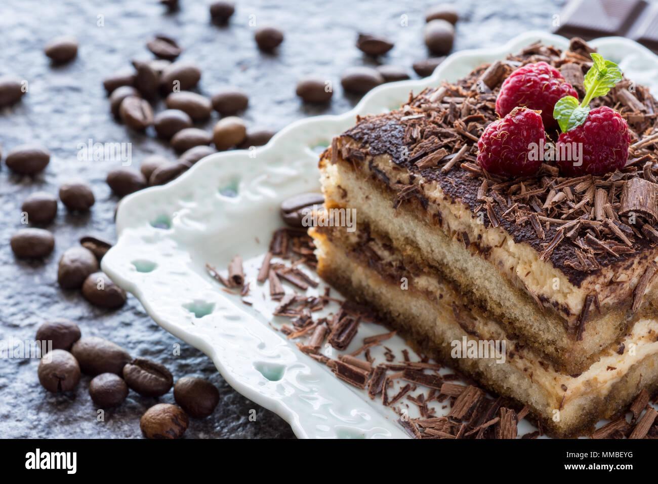 Dessert Tiramisu Cake with Grated Chocolate, Raspberry and Mint - Stock Image