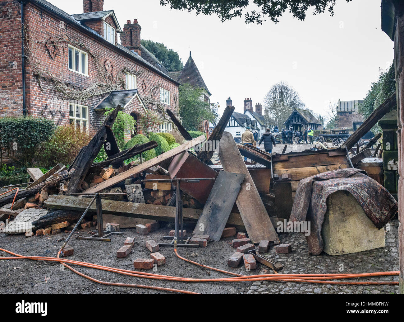 11th April, 2018. Props and debris with flame bars being set up for a dramatic scene in Great Budworth, cheshire Village for war of the worlds. - Stock Image