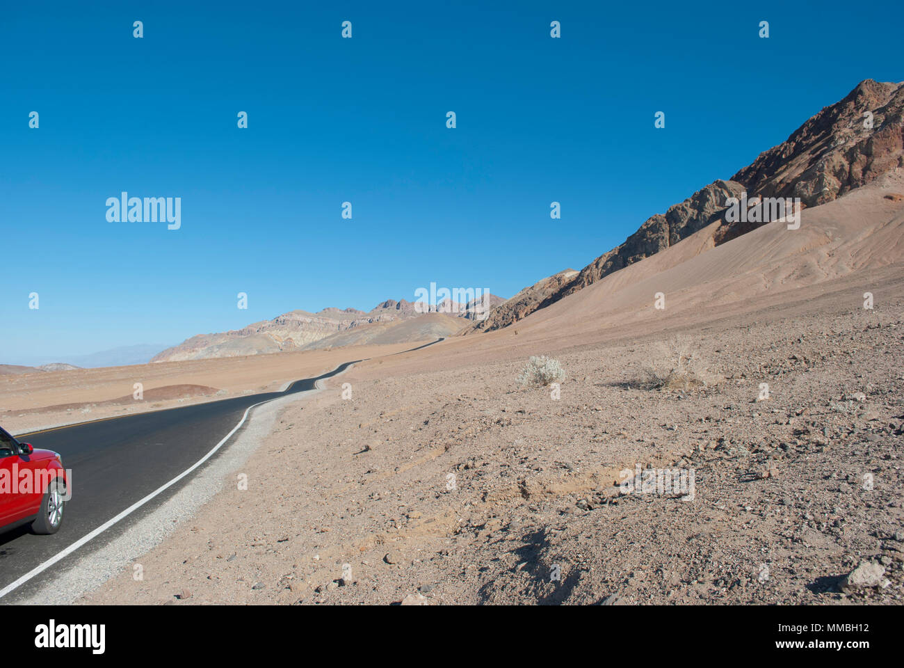 Traveling by car into the wild desert. Vacation destination. Mountains landscape. Hot weather. Dry, thirst  concept, Open panoramic view - Stock Image