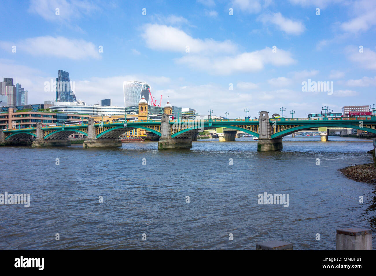 Southwark Bridge, the River Thames and London's city skyline featuring 20 Fenchurch St, 122 Leadenhall St and Tower 42. - Stock Image