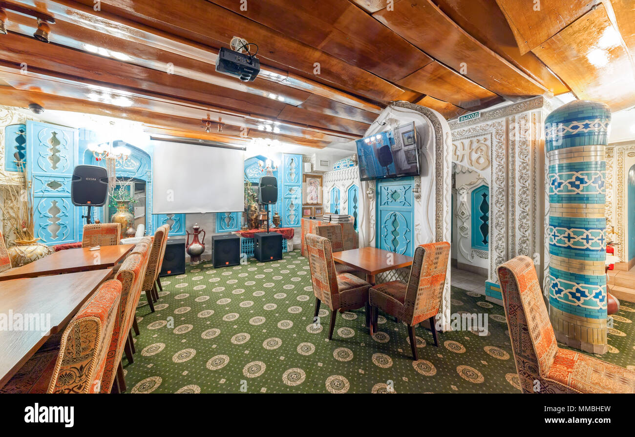 MOSCOW - AUGUST 2014: Deluxe interior karaoke bar - 'VINYL'. The hall is decorated in oriental, Arabic style - Stock Image