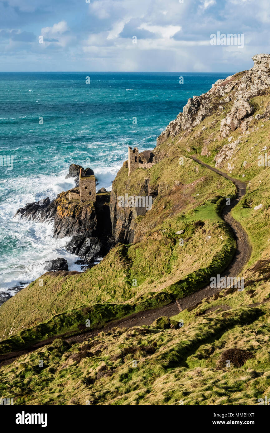 Botallack Crown Mines, view down onto ruined mine workings and wheel house on the cliffs, and view out to sea. - Stock Image