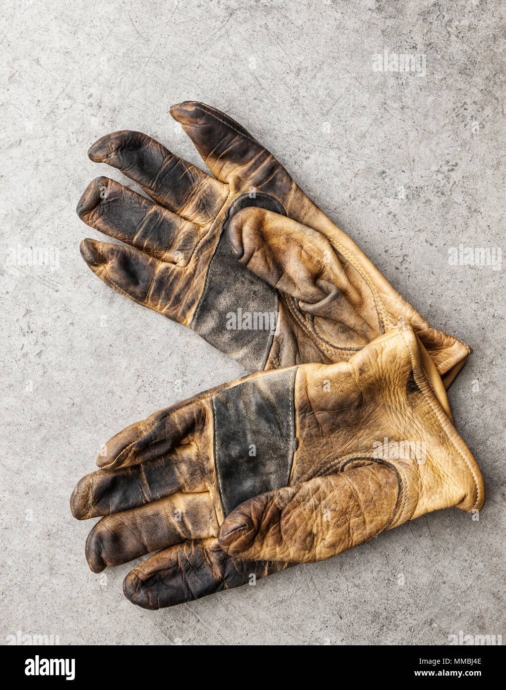 Close-up of a pair of used work gloves in a shop - Stock Image