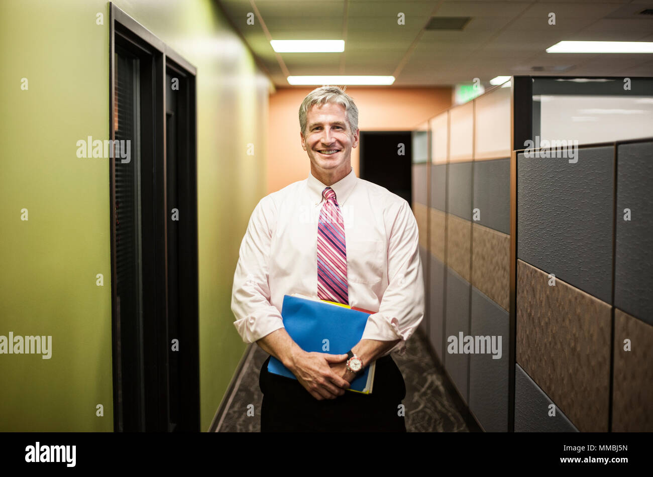 Caucasian man in an office hallway - Stock Image