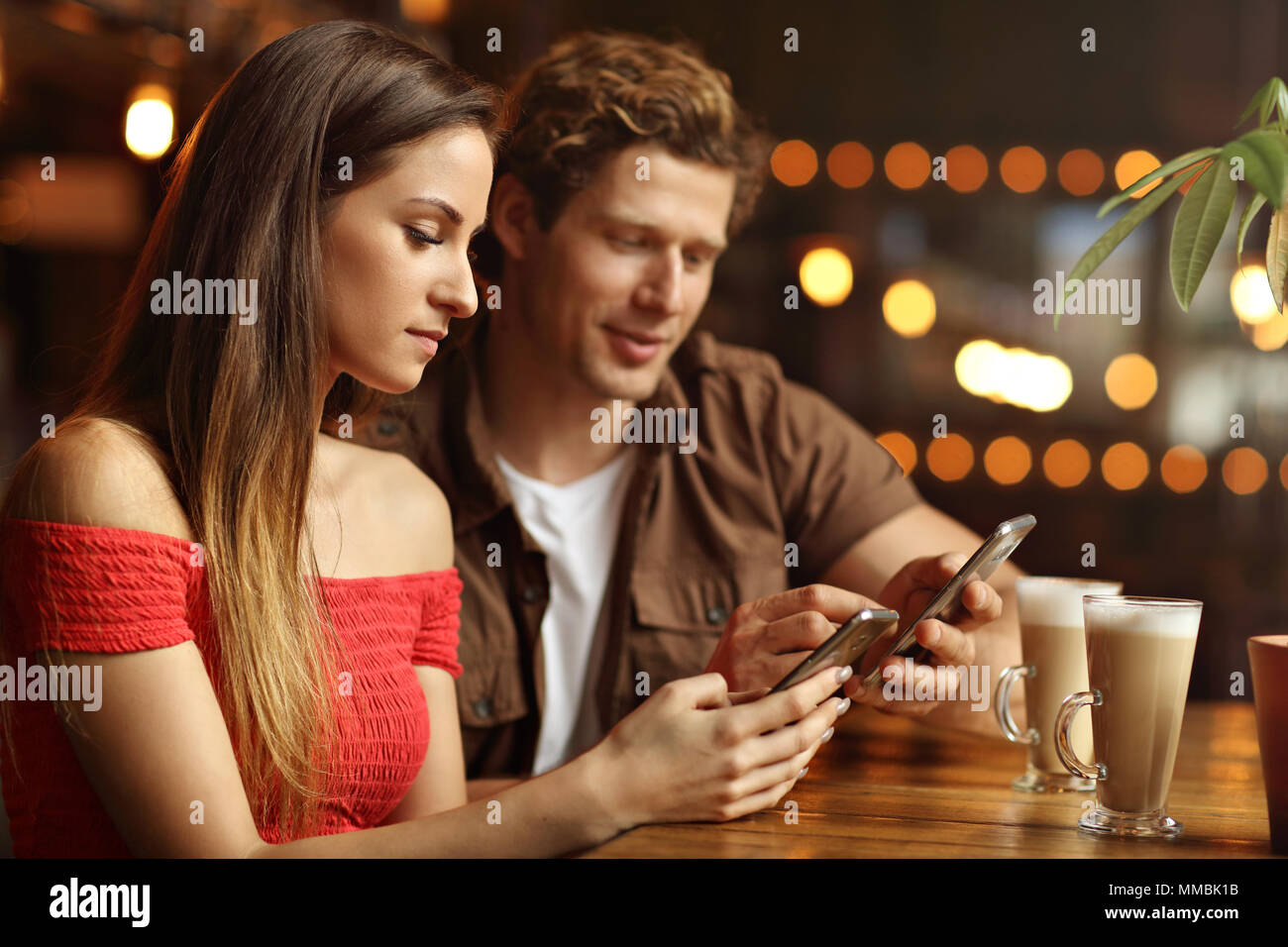 Cute couple on a date at the cafe - Stock Image