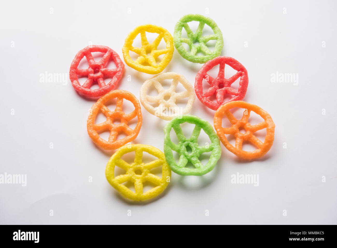 wheel shape colourful fryums papad snack. selective focus - Stock Image