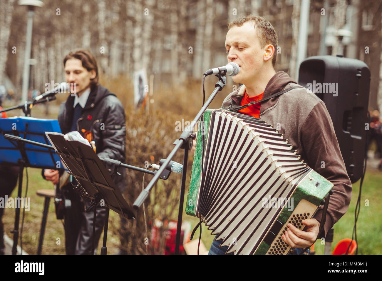 musicians sing songs on the street on victory day Stock Photo