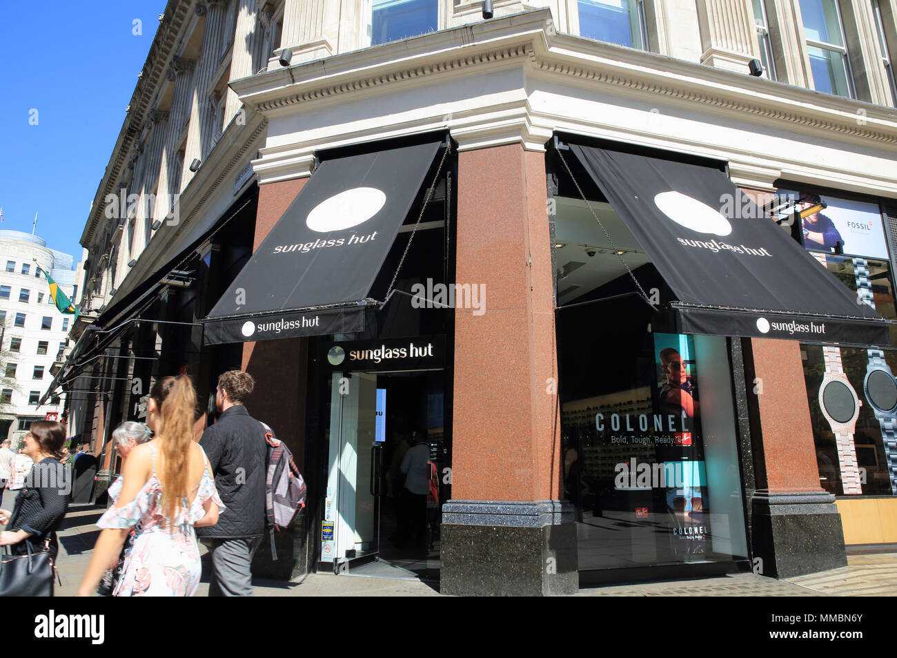 Sunglass Hut on Oxford Street, in central London, England, UK - Stock Image
