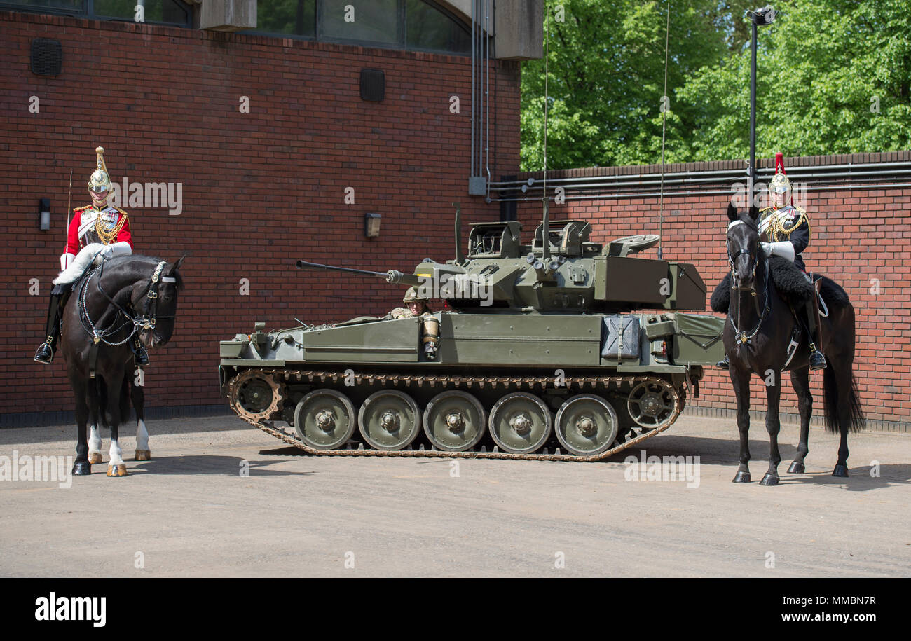 London, UK. Life Guard & Blues and Royals Mounted Cavalry with Spartan APC mechanised cavalrymen. - Stock Image