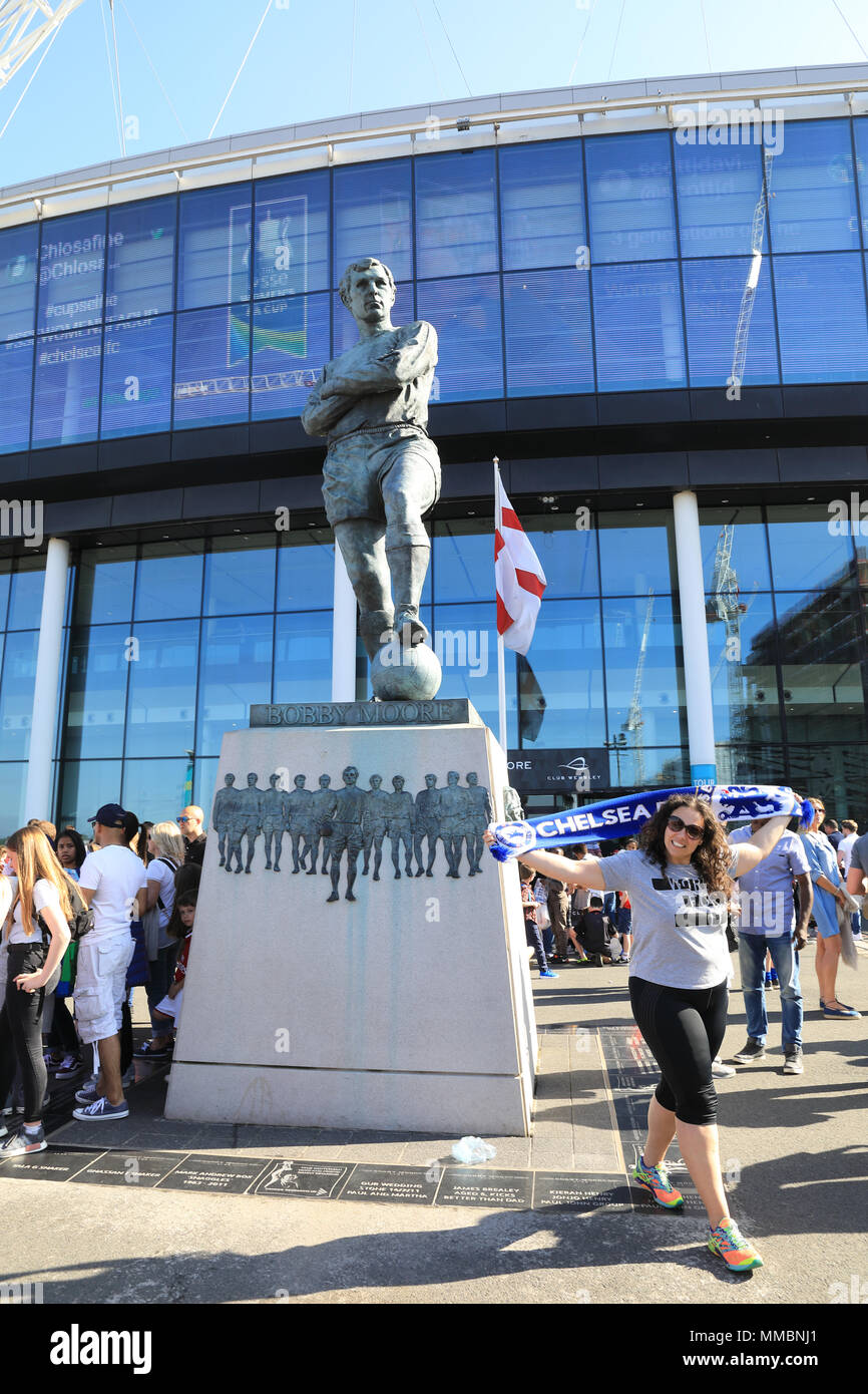 The bronze sculpture of footballing legend Bobby Moore, outside Wembley Stadium, home of the national England football team, in NW London, UK - Stock Image