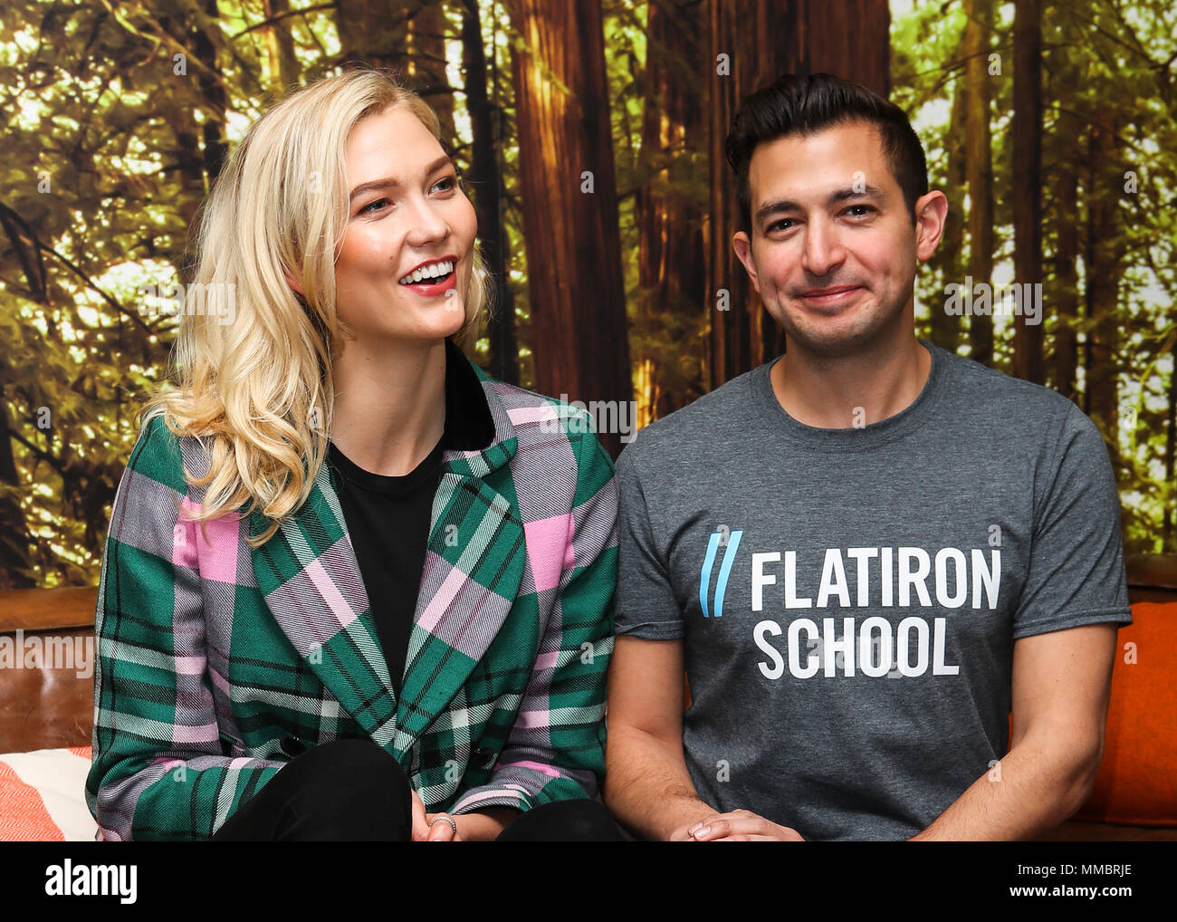 Karlie Kloss attends a photo call alongside Avi Flombaum, co