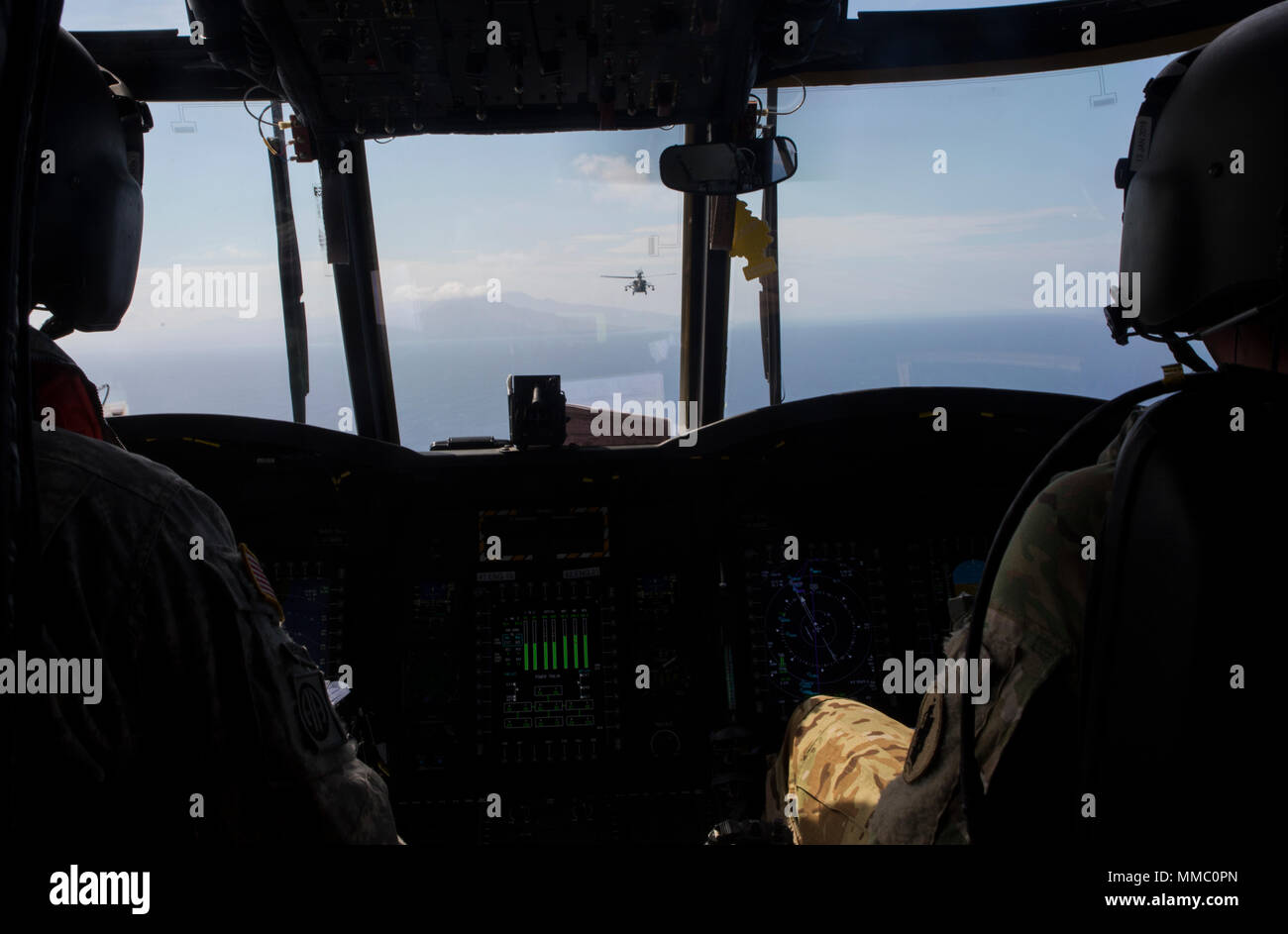 Two U S  Army CH-47 Chinook helicopter pilots with Joint Task Force