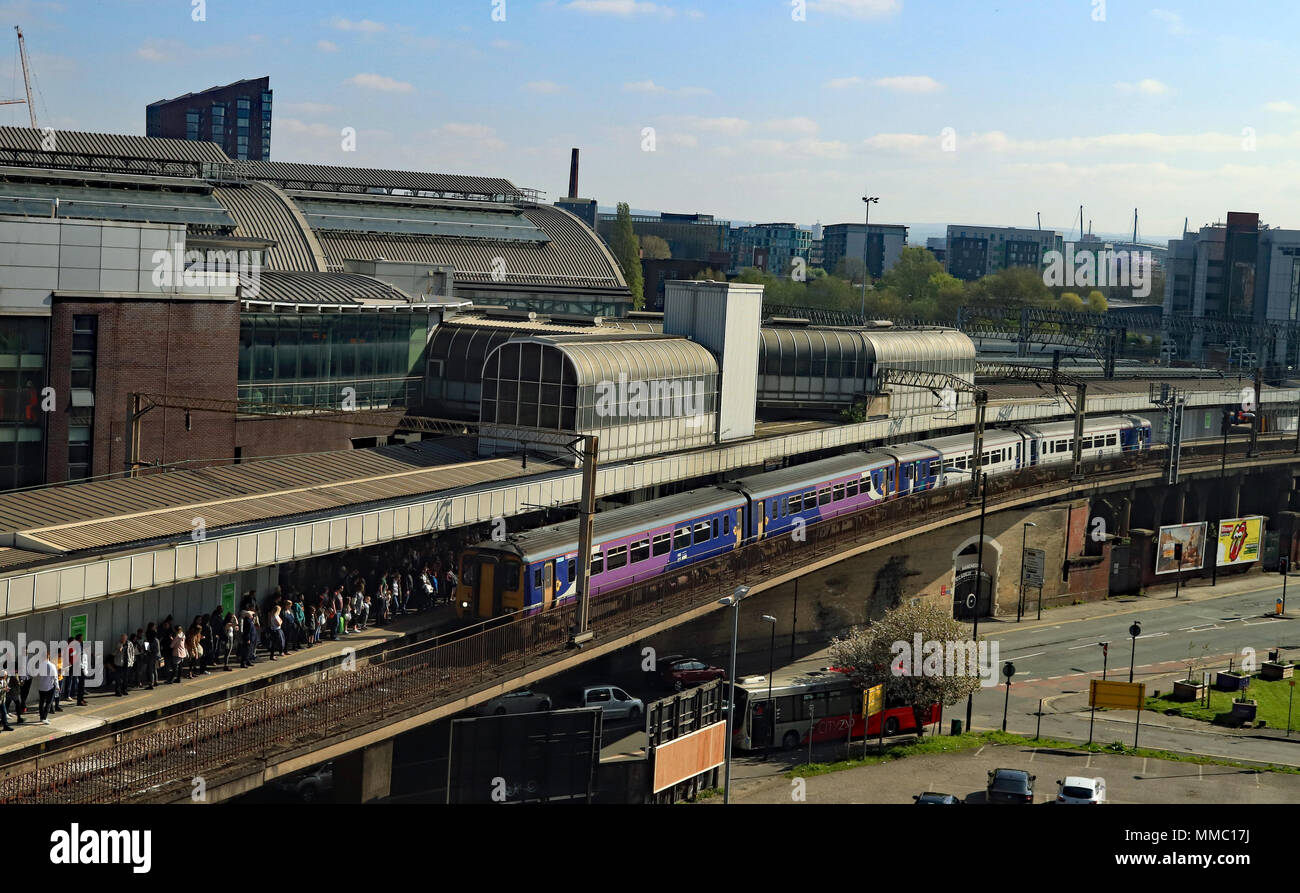 On a Bank holiday Saturday a Northern train arrives in platform 14 at Manchester Piccadilly with a service from Manchester Airport to Blackpool North. Stock Photo