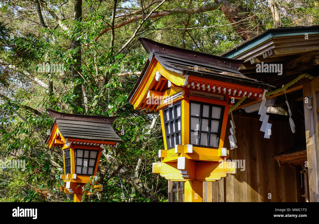 Wooden Traditional Japanese Lanterns At The Garden Of Shinto Shrine