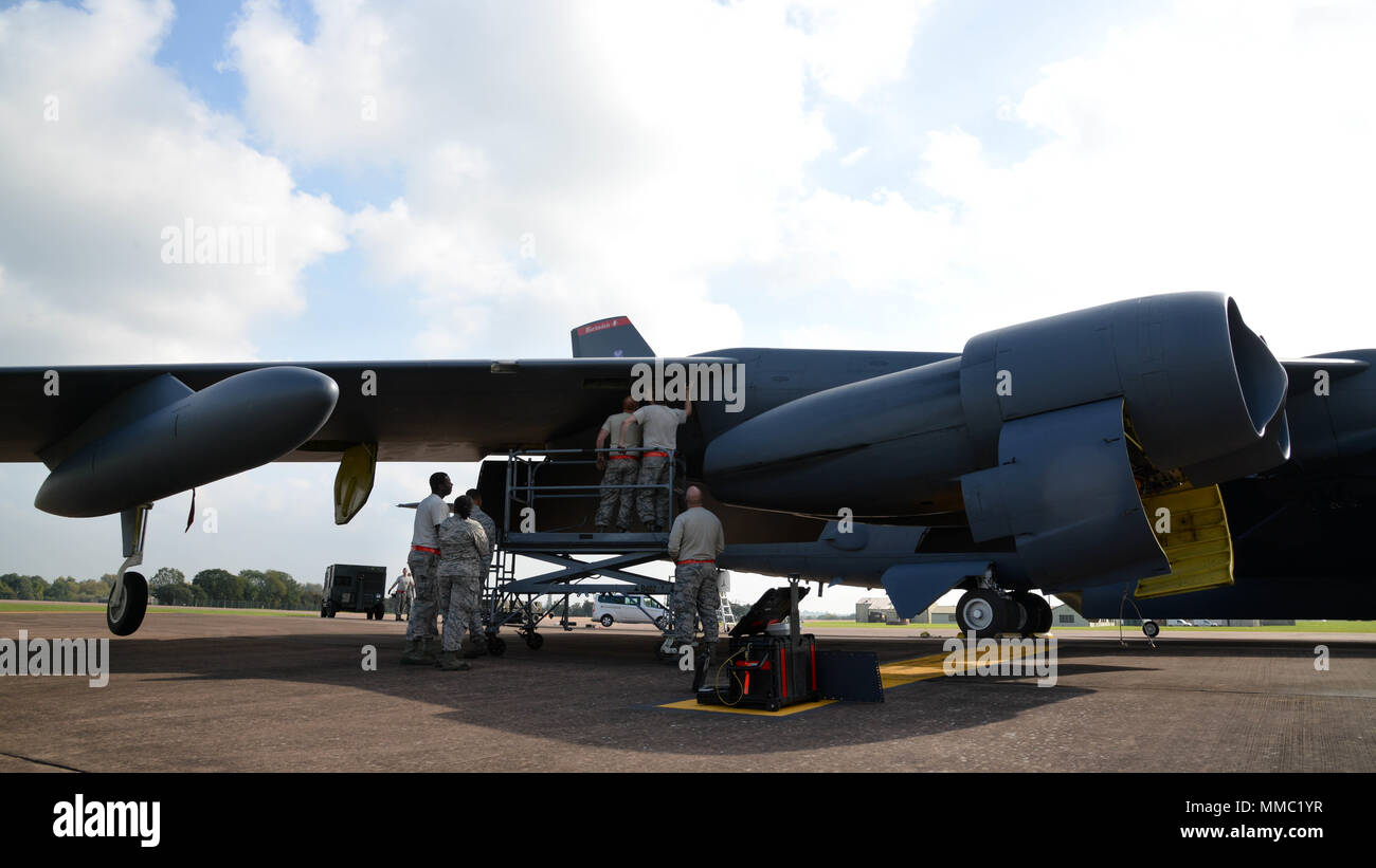 Maintainers from the 96th Aircraft Maintenance Unit remove a panel from a B-52  Stratofortress 7d1172675b2a6