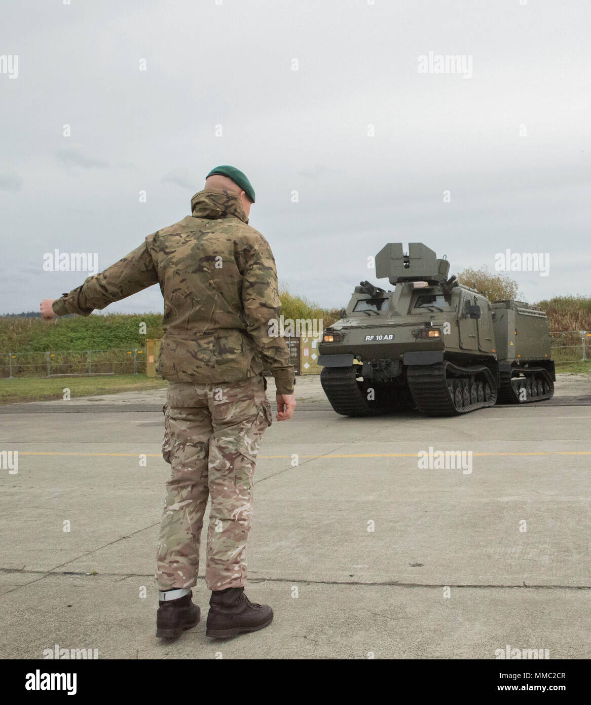 a british royal marine helps position the bvs 10 by providing hand