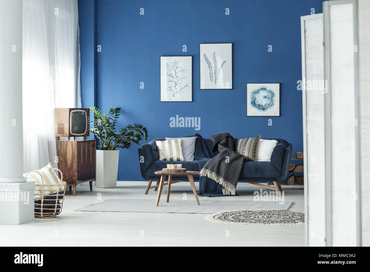 Spacious Blue And White Living Room With Old Small Television Stock Photo Alamy