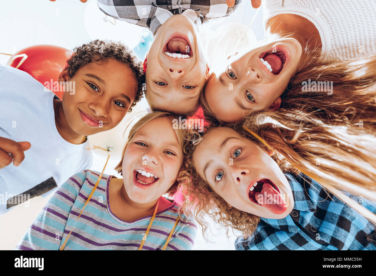 Group of children friends laughing and having fun - Stock Image