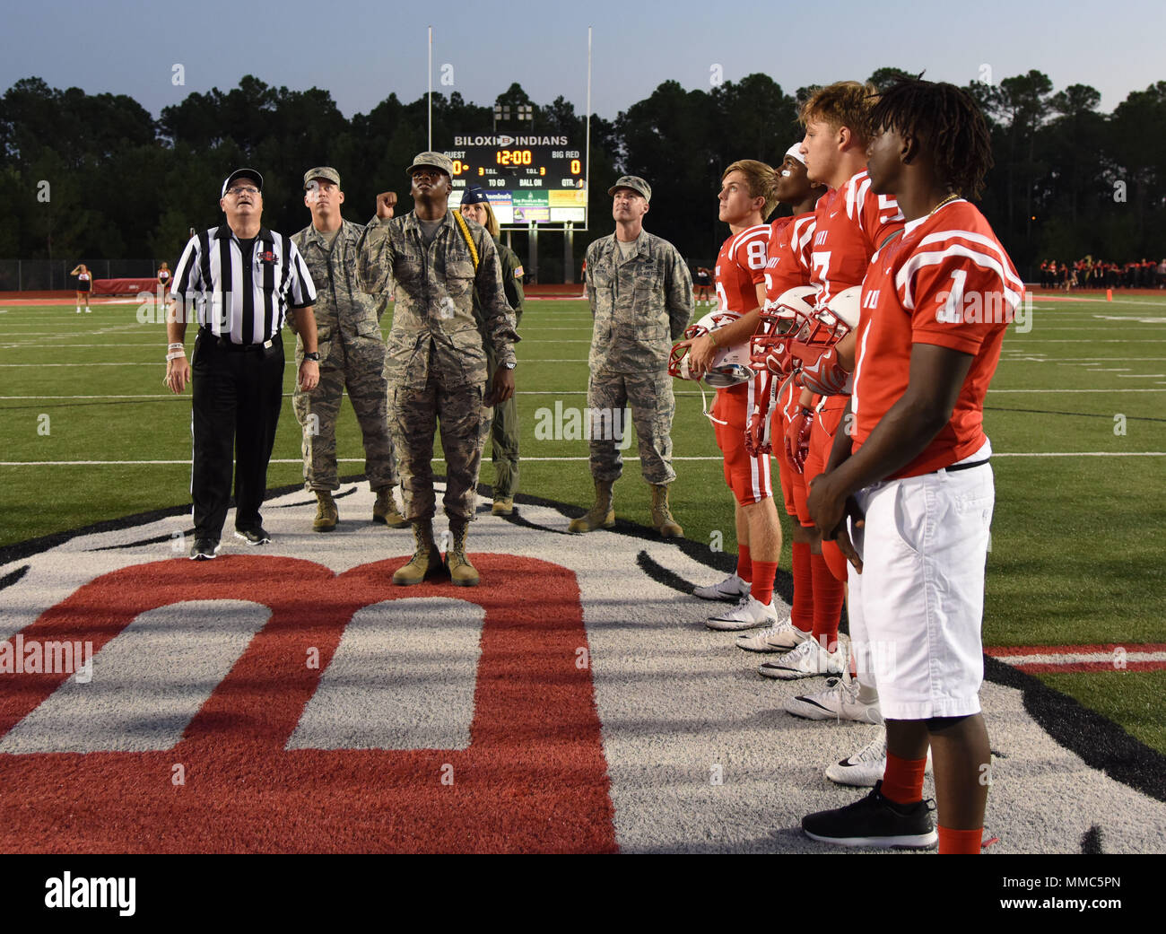 Keesler Leadership And Personnel Participate In A Coin Toss