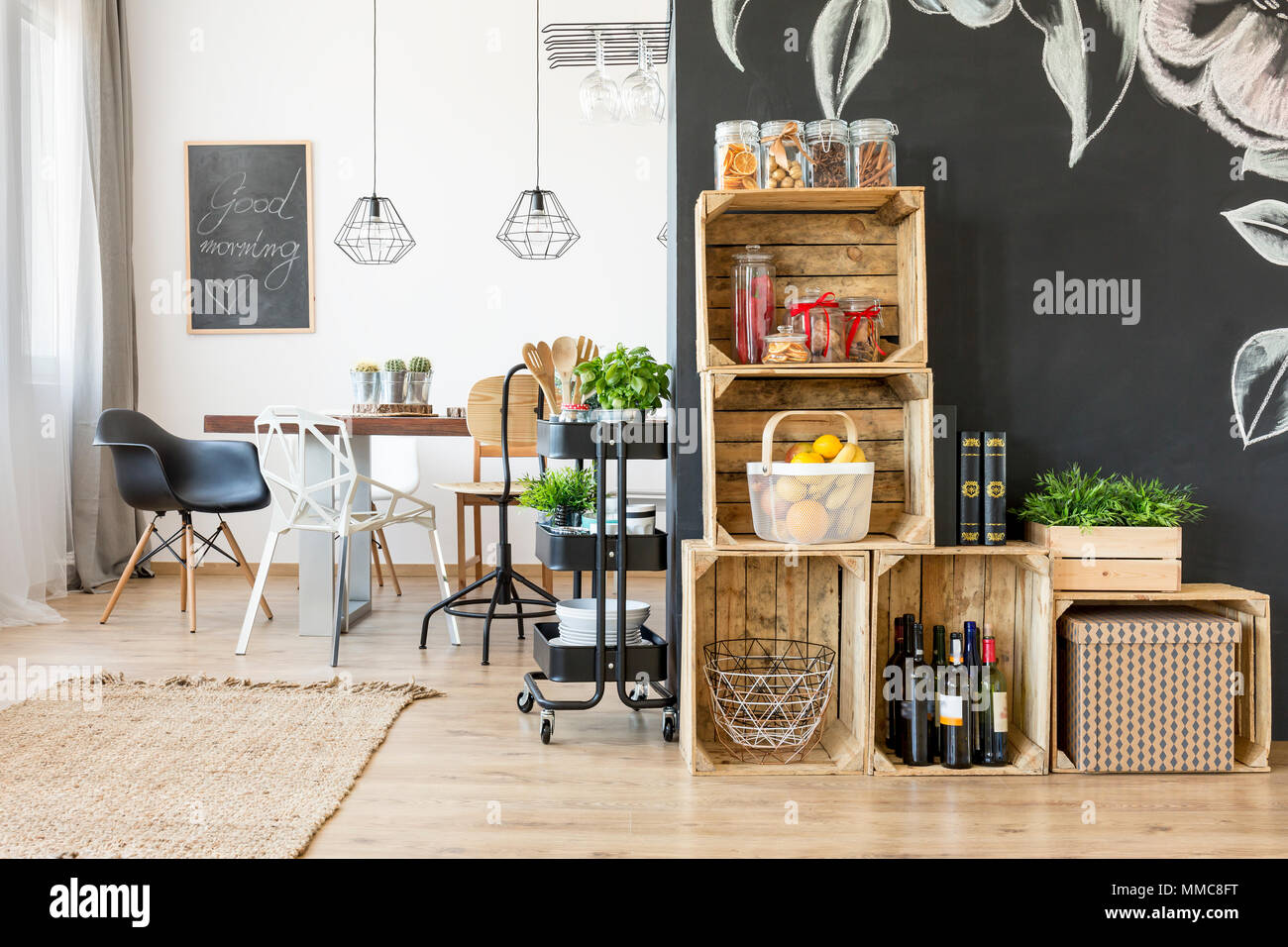 Interior with dining table and diy crate shelves - Stock Image