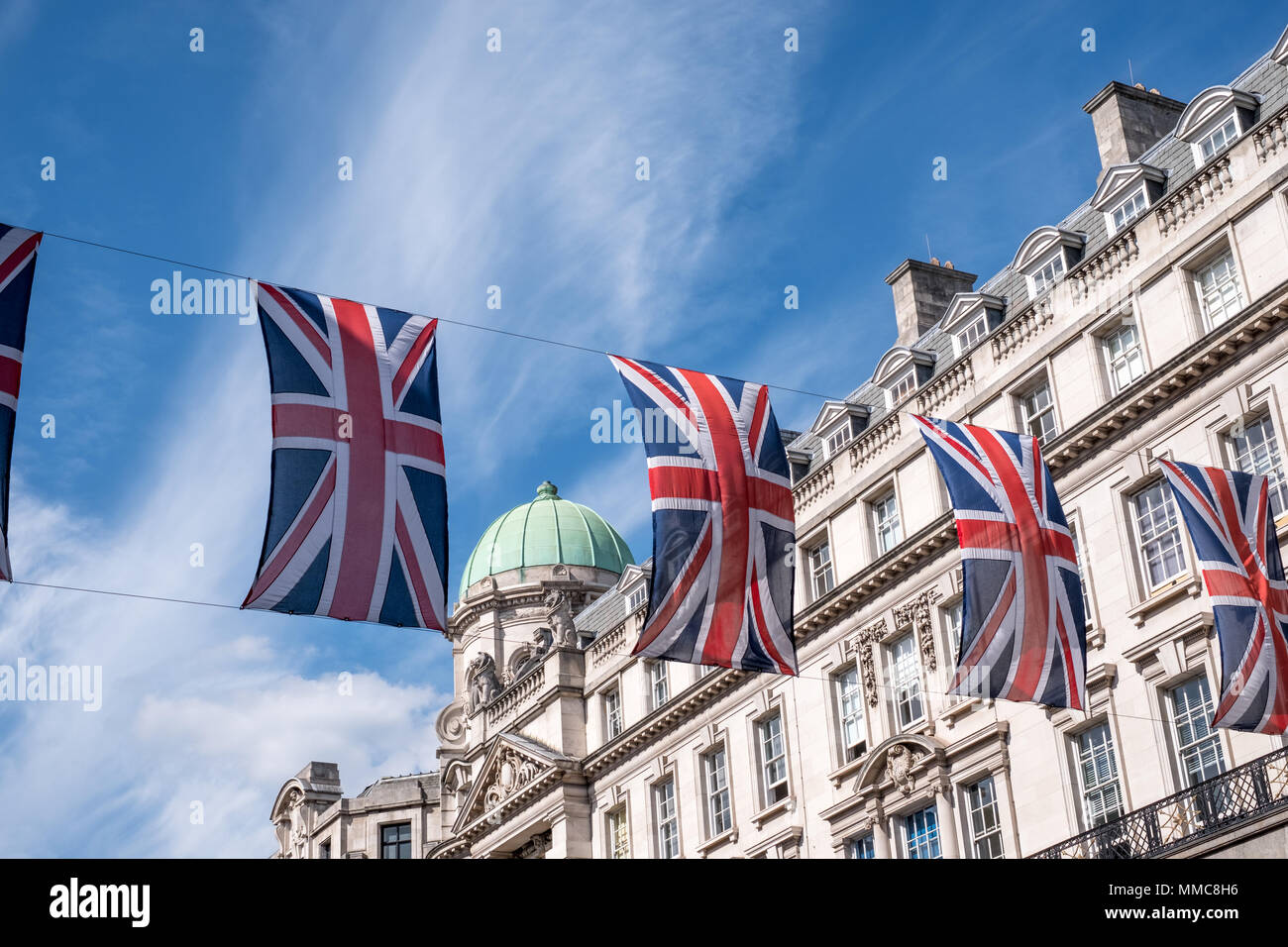 Close up of buildings on Regent Street London with row of British flags to celebrate the Royal Wedding of Prince Harry to Meghan Markle. Stock Photo