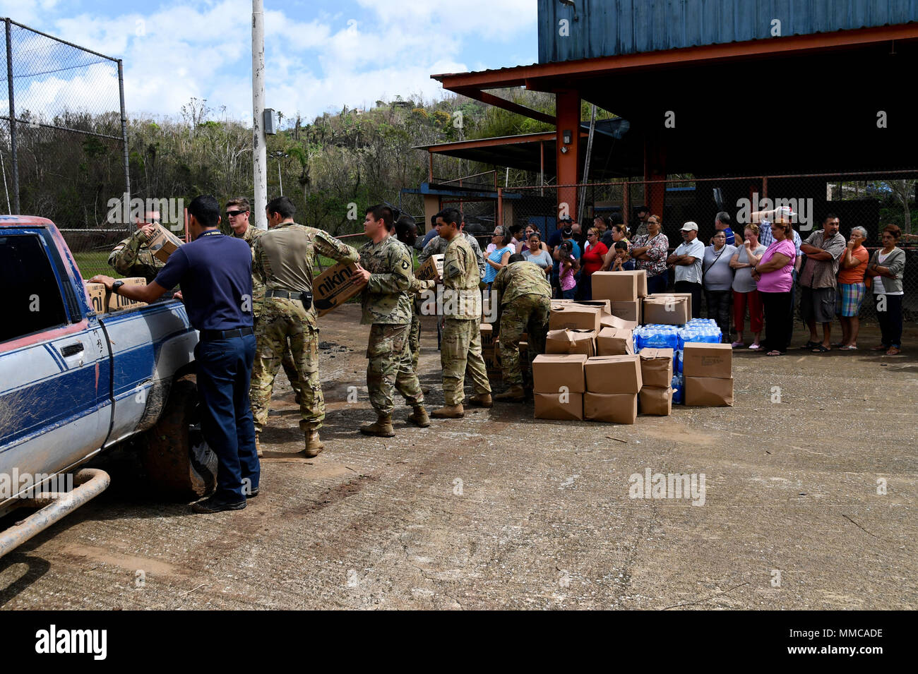 Soldiers with the 6th Battalion, 101st General Support Aviation Battalion, 101st Combat Aviation Brigade, 101st Airborne Division (Air Assault) and from the 1st Armored Division, deliver food and water October 11, 2017 to Castaner, Puerto Rico. The Soldiers are supporting FEMA relief efforts after the devastating effects of Hurricane Maria. (U.S. Army photo by Sgt. Marcus Floyd) - Stock Image