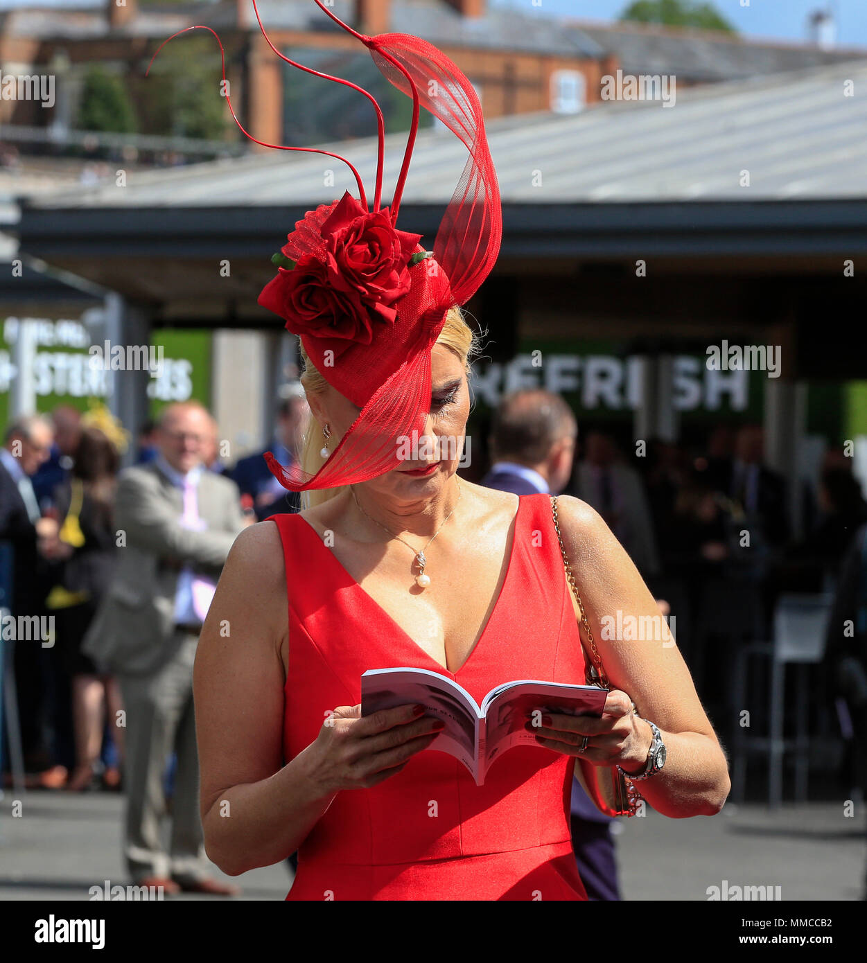 Chester Racecourse, Chester, UK. 10th May, 2018. The Boodles May Festival, Ladies Day; Studying the form book at Chester races Credit: Action Plus Sports/Alamy Live News - Stock Image