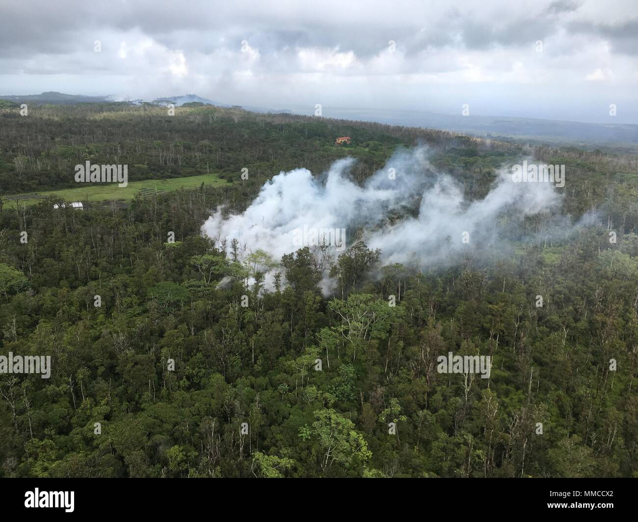 Leilani Estates, Hawaii. May 9, 2018. Aerial view of lava and steam spewing from fissures caused by the Kilauea volcano eruption May 9, 2018 in Leilani Estates, Hawaii. The recent eruption continues destroying homes, forcing evacuations and spewing lava and poison gas on the Big Island of Hawaii. Credit: Planetpix/Alamy Live News Stock Photo