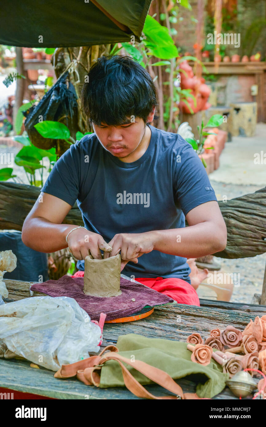 Lopburi, Thailand - July 21, 2013: Craftsman making pottery of dolls and sculpture of animals from clay in the workshop in Lopburi, Thailand - Stock Image