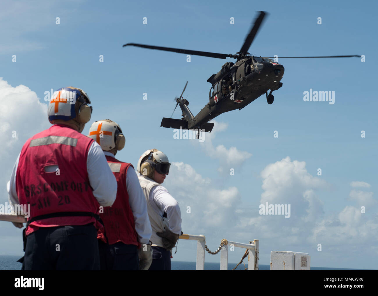 171014-N-MU198-049 CARIBBEAN SEA (Oct. 14, 2017)  A U.S. Army UH-60 Black Hawk helicopter assigned to C Co., 6th Battalion, Combat Aviation Brigade, approached the flight deck of the Military Sealift Command hospital ship USNS Comfort (T-AH 20) in order to complete day landing qualifications (DLQ). Comfort is operating in the vicinity of San Juan, Puerto Rico, to provide medical services with additional visits being planned around the island. The U.S. Health and Human Services and Puerto Rico Department of Health representatives are prioritizing patients at each stop prior to Comfort's arrival Stock Photo